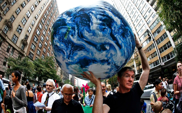 A man carries an inflatable earth balloon along West 72nd Street during the People's Climate March in New York